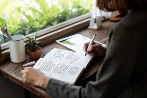 girl writing book image